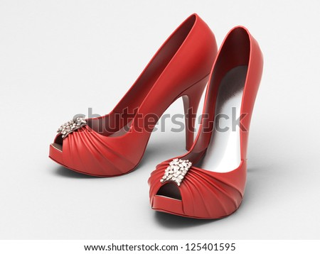 Women's red shoes closeup on a light background
