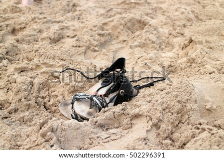 Women's sandals in the sand