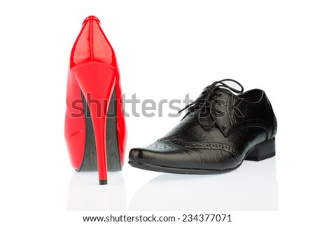 women's shoes and men's shoes, symbolic photo for partnership and equality - stock photo
