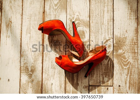 Women's shoes on a wooden background - stock photo
