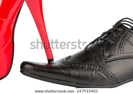 women's shoes on men's shoe, symbolic photo for separation, divorce and conflict - stock photo