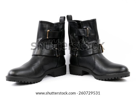 Women's shoes type ankle boot in black leather, photographed on white background