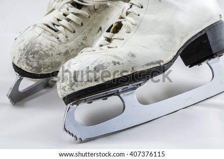 Women's white figure skates show their wear after many years of use.  - stock photo