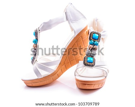 Women's white summer sandals with rhinestones. Isolated on white background - stock photo