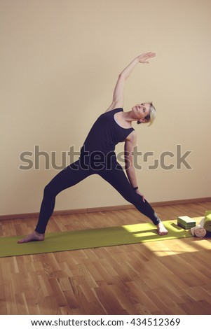 Women's Yoga makes in standing on yoga mat