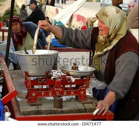 women selling fish in a Turkish fish market