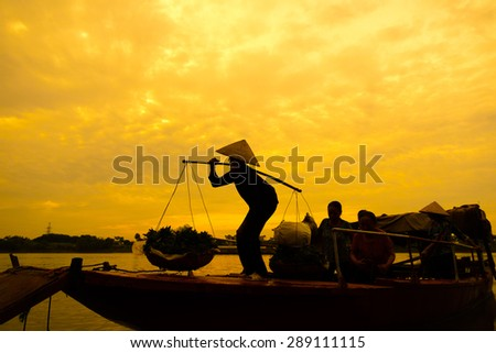 Women selling flowers on a boat in the early morning