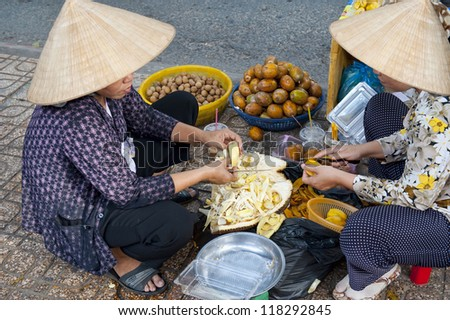 Women Selling Fruit on the streets of Ho Chi Minh City in Saigon - stock photo
