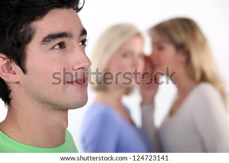 women sharing secrets about young man - stock photo