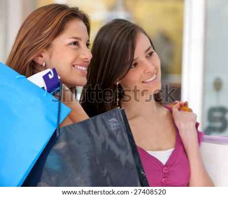 women shopping in a mall with some bags