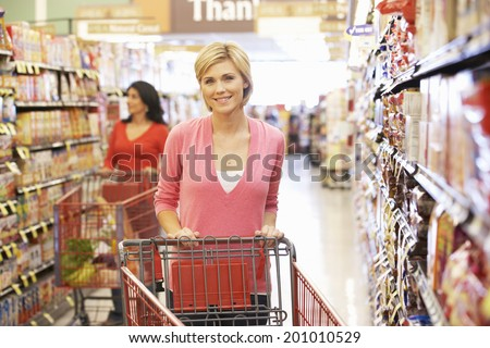 Women shopping in supermarket - stock photo