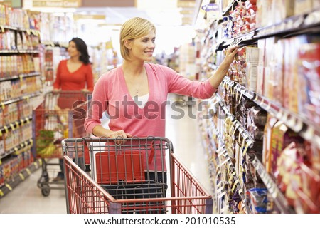 Women shopping in supermarket - stock photo