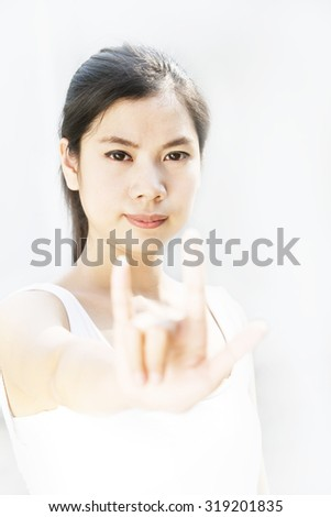 women showing love hand sign - stock photo