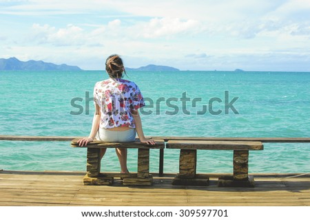 women sit on chair in Wooden pier on summer season - Wooden pier in Kho mak, Thailand