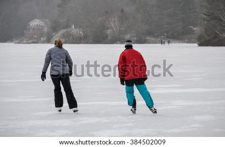 Women skating on a frozen lake