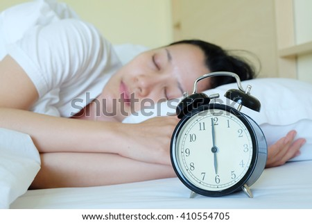 Women sleep and clock