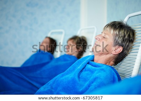 Women sleeping in relaxation room after sauna - stock photo