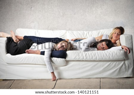 women sleeping on the sofa - stock photo