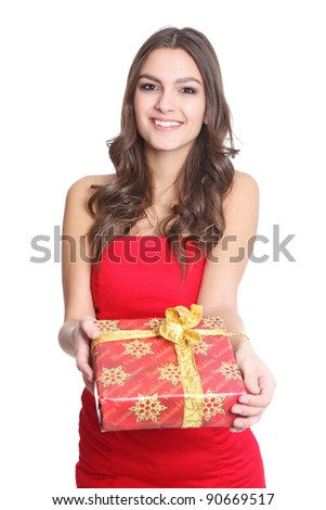 Women smiling with a gift in her hand - stock photo