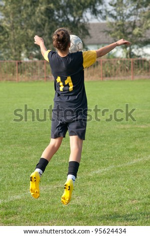women soccer on the sports field - stock photo
