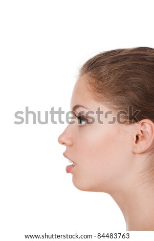 women speaking, a closeup of a young girl whispering over white background - stock photo