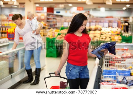 Women spending their time in shopping store