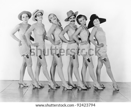 Women standing in a chorus line in lingerie - stock photo