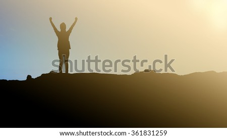 women standing on mountain in silhouette style, concept in winner and success