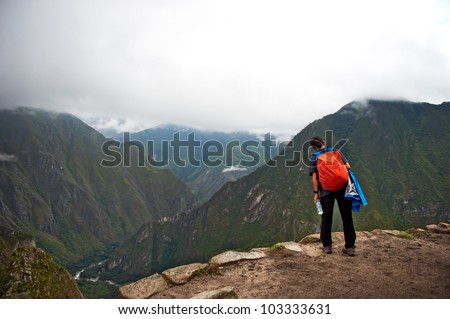 Women standing on the edge of the cliff, looking at the deep abyss - stock photo