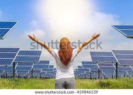 women standing raised up arms achievements successful and celebrate success to sunlight in solar farm station