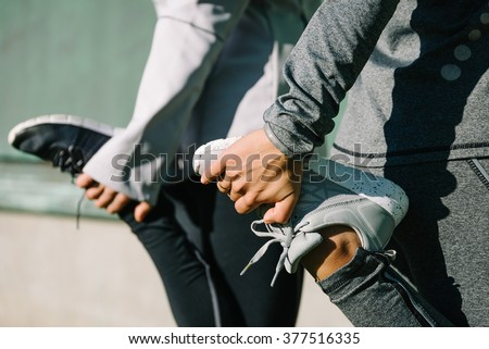 Women stretching for warming up before running or working out. Fitness and healthy lifestyle concept. - stock photo