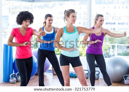Women stretching hands at fitness studio - stock photo