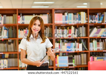 women student in library