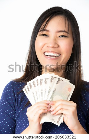 women success holding money in her hands