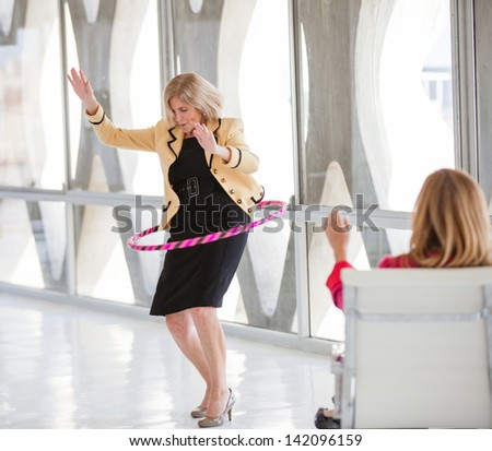 Women taking a play Break in a modern office to get ideas flowing - stock photo