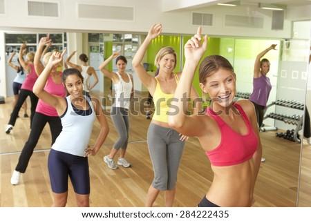 Women Taking Part In Zumba Class In Gym - stock photo