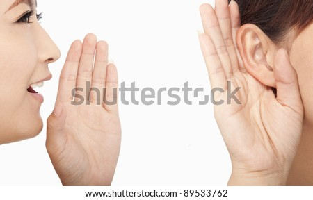 women talking and listening to gossip - stock photo