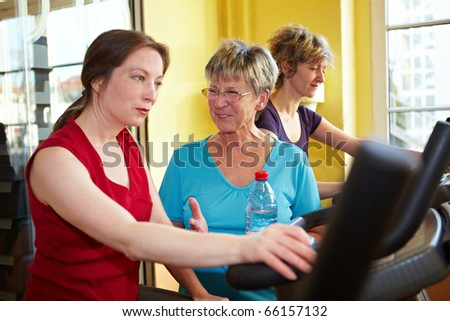 Women talking while in a gym - stock photo