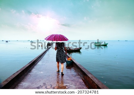 Women to go on the jetty - stock photo