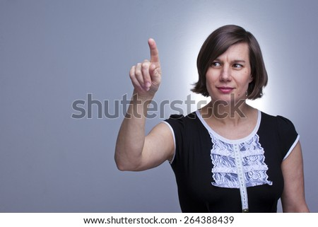 Women touching the screen on white background - stock photo