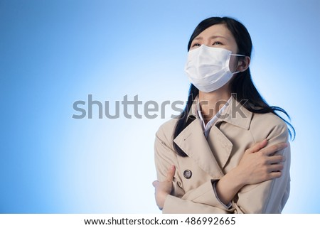 Women , trench coat , mask , cold , disease , blue back