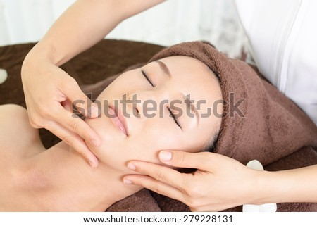 Women undergoing facial massage