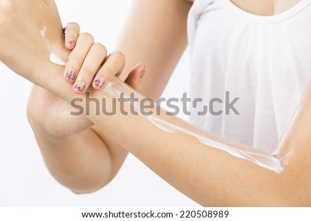 Women use body lotion on your arms. - stock photo