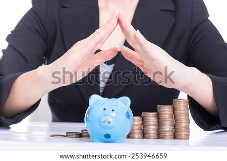 Women use hands to shield her money for safe investment in the future. - stock photo