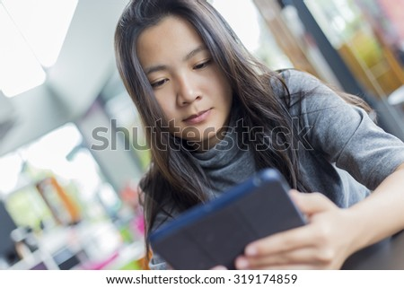 Women Use Tablet for Business in Cafe