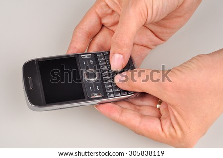 Women using a PDA mobile phone, blank screen - stock photo