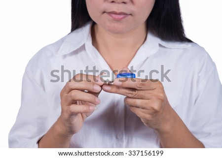 Women using contact lenses.