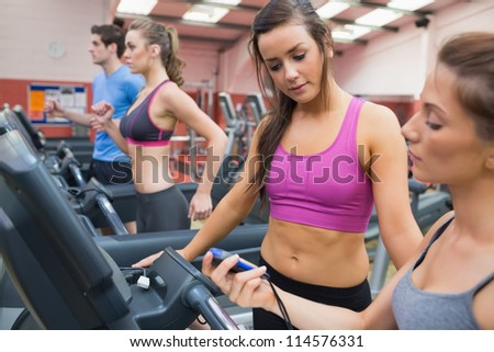 Women using stopwatch in the gym