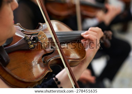 Women Violinist Playing Classical Violin Music in Musical Performance - stock photo