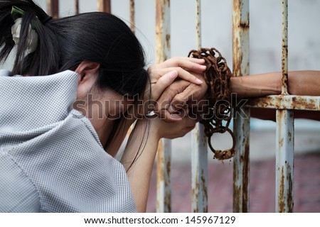 women visit prisoner in jail - stock photo